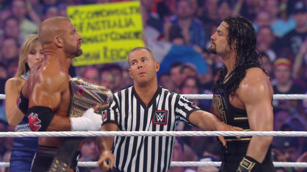 WWE - Roman Reigns Faces Off with Triple H at WrestleMania 32